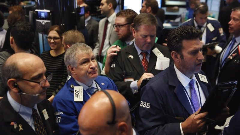 Wall St. opens up bit changed; Intel weighs