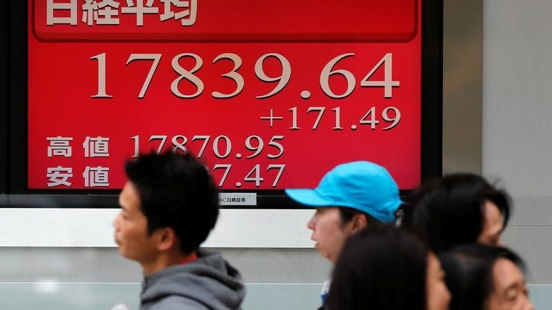 Japan shares rise to close 11-mth large, dollar bulls continue charge